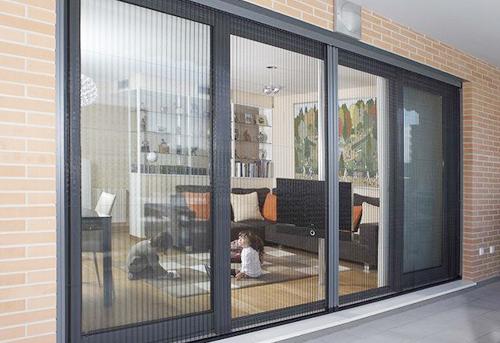 Fabricantes e instaladores de mosquiteras enrollables for Mosquiteras plisadas para puertas
